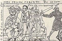 A crowned man and a man who wears a tiara, each sitting on a throne with two armed men in the background