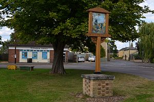 Willingham, Cambridgeshire - Willingham village sign, green and library in July 2014