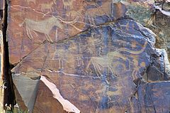 Complex hunting scene in a bronze age petroglyph at Tamgaly, Kazakhstan.jpg