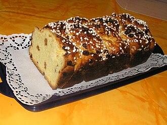 Cozonac - Bulgarian Kozunak with raisins, braided and sprinkled with sugar.