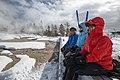 Cross-country skiers sit on bench on boardwalk by Grand Geyser (78ad518d-dba1-4473-91a1-1a4b4f6dac20).jpg