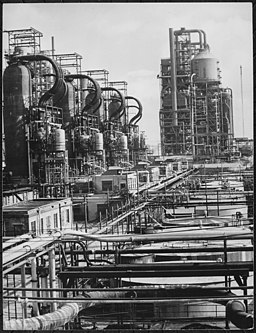 "Crude-oil pipe stills, rundown tanks, and ""Cat Crackers"" at the Baton Rouge Esso Refinery, ca. 1945 - NARA - 535733"