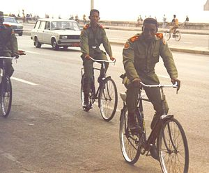 OG-107 - Cuban soldiers on bicycles wearing a very similar uniform.