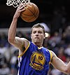 David Lee is with the Golden State Warriors in air with a ball in hand