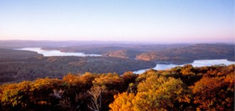 Maryland - Western Maryland: known for its heavily forested mountains. A panoramic view of Deep Creek Lake and the surrounding Appalachian Mountains in Garrett County.