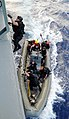 Defense.gov News Photo 101115-N-3666S-055 - U.S. Navy sailors with a visit board search and seizure team from the guided-missile frigate USS Reuben James FFG 57 board the fleet.jpg