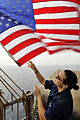 Defense.gov News Photo 110704-N-EE987-066 - Seaman Ingrid Devinkayne sets Fourth of July colors on the weather deck of the aircraft carrier USS Ronald Reagan CVN 76 in the Arabian Sea on July.jpg