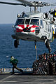 Defense.gov News Photo 111221-N-OY799-360 - An MH-60S Sea Hawk helicopter from Sea Combat Squadron 8 picks up stores from the flight deck of the Military Sealift Command fast combat support.jpg