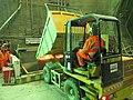 Digger dumps Crossrail soil (11421370444).jpg