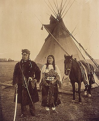 Buffalo coat - Image: Dog Child, a North West Mounted Police scout, and his wife, The Only Handsome Woman, members of the Blackfoot Nation, Gleichen, Alberta, ca. 1890