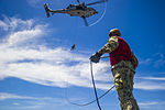 EOD Sailors rappel aboard USS George Washington 140909-N-TE278-425.jpg