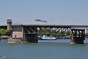 East fixed span of Morrison Br, with sternwheeler Portland at seawall.jpg