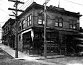 Edgewater Pharmacy and Edgewater Hardware at Woodland Park Ave and N 36th St, ca 1906 (SEATTLE 179).jpg