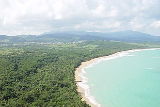 Northeast Ecological Corridor - El Convento Beach within the Northeast Ecological Corridor (Fajardo, Puerto Rico) and panoramic view of El Yunque National Forest in the background.