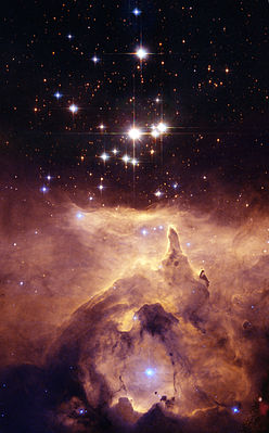 The star cluster Pismis 24 lies in the core of the large emission nebula NGC 6357 that extends one degree on the sky in the direction of the Scorpius constellation.