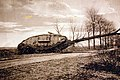 English tank overturning and crashing into a tree during WWI (29126524520).jpg