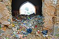 Entrance and steps obstructed by garbage being dumped in the Tulsian Bawri, Jhunjhunu.jpg