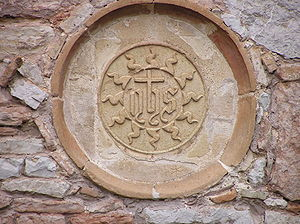 Eremo delle Carceri - Seal of Saint Bernardino of Siena at the outer wall.
