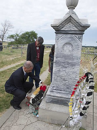 Eric Holder - Holder laying a wreath at the memorial site of the Wounded Knee Massacre in South Dakota