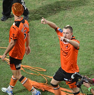Besart Berisha - Berisha and Erik Paartalu celebrating Brisbane's 2012 A-League Grand Final win in 2012.