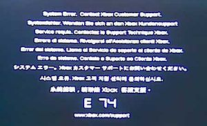 """The error code E74. Above the large E 74 code is the message """"System Error. Contact Xbox Customer Support."""" repeated in different languages."""