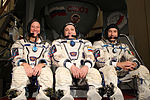 Expedition 34 backup crew members in front of the Soyuz TMA spacecraft mock-up in Star City, Russia.jpg