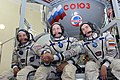 Expedition 49 backup crew members in front of the Soyuz TMA spacecraft mock-up in Star City, Russia.jpg