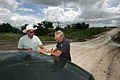 FEMA - 31064 - FEMA worker and local official survey damage in Texas.jpg