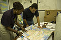 FEMA - 32526 - FEMA Community Relations workers looking at map of Queens.jpg