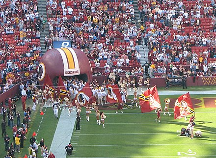 Redskins players enter the field during a game in October 2006. FedExField02.jpg