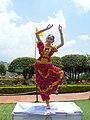 Female dancer wearing a dress full of roses.jpg