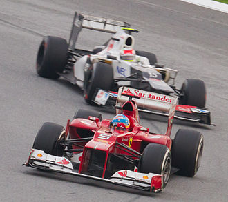 Sergio Pérez - Pérez chasing Alonso for the lead of the 2012 Malaysian Grand Prix, where he achieved his first podium in Formula One.