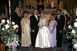 Filipino wedding at the St. Edward's Parish in...