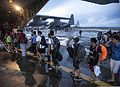 Filipino civilians displaced by Typhoon Haiyan board a U.S. Marine Corps KC-130J Super Hercules aircraft assigned to Marine Aerial Refueler Transport Squadron (VMGR) 152, Marine Aircraft Group 36, 1st Marine 131112-M-GX379-617.jpg