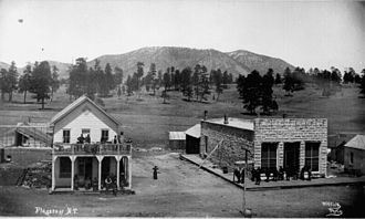 Flagstaff, Arizona - Flagstaff ca. 1899; view of Post Office and other buildings on Terrace Street