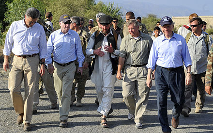 "The ""Three Amigos"" walking in Kunar Province in eastern Afghanistan in July 2011: McCain (second from left), Lindsey Graham (second from right in front), Joe Lieberman (right in front) Flickr - DVIDSHUB - Senators visit special operations forces soldiers in eastern Afghanistan (Image 6 of 15).jpg"