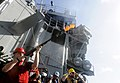 Flickr - Official U.S. Navy Imagery - A Sailor fires a shot line before an underway replenishment..jpg
