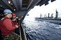 Flickr - Official U.S. Navy Imagery - A Sailor fires a shot line during a replenishment at sea..jpg