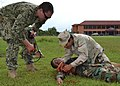Flickr - Official U.S. Navy Imagery - A Sailor trains a Cambodian medic in first aid..jpg