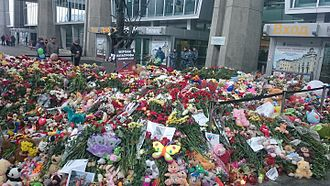 "Metrojet Flight 9268 - Flowers and children's toys at the Pulkovo Airport entrance. The sign at the back says ""To the victims of A321 plane crash""."