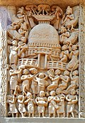 Foreigners making a dedication to Stupa 1at the Northern Gateway of Stupa 1 Sanchi.jpg