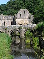 Fountains Abbey and bridge over the River Skell.JPG