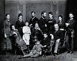 Freud family - Freud family portrait, 1876. Standing left to right: Paula, Anna, Sigmund, Emmanuel, Rosa and Marie Freud and their cousin Simon Nathanson. Seated: Adolfine, Amalia, Alexander and Jacob Freud. The other boy and girl are unidentified.