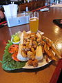 Fried shrimp po-boy sandwich with fries and beer.jpg