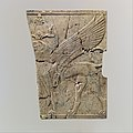 Furniture plaque carved in relief with a winged, falcon-headed sphinx MET DP115140.jpg