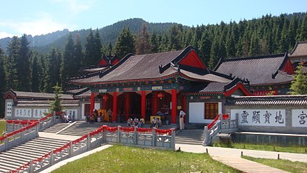Temple of Fortune and Longevity, at the Heavenly Lake of Tianshan in Fukang, Changji, Xinjiang. It is an example of Taoist temple which hosts various chapels dedicated to popular gods. Fushou (Fortune and Longevity) Taoist Temple at Tianchi (Heavenly Lake) in Fukang, Changji, Xinjiang.jpg