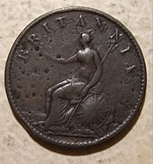 A worn copper coin with Britannia on it