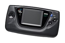 "A black Game Gear handheld system. From left to right: the directional controls, the screen, and two buttons labeled ""1"" and ""2""."