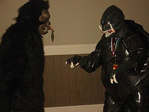 Gorilla suit - An actor in a gorilla suit spars with an actor in a Gamera costume at CONvergence (convention).