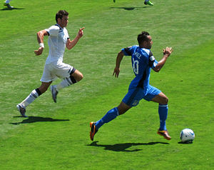 Gareth Bale - San Jose Earthquakes' Arturo Álvarez evades Bale (left) in a July 2010 friendly in San Jose, California.
